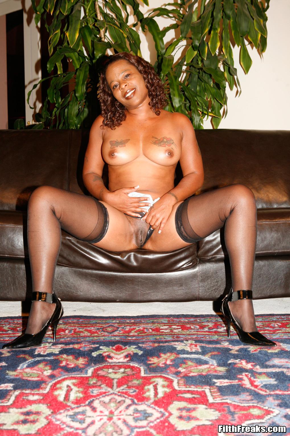 Spreads her legs black mature