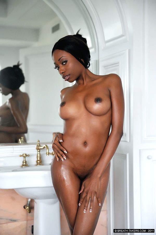 Nude ebony taking bath
